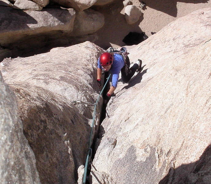 Christa Cline jamming the final moves to the top.