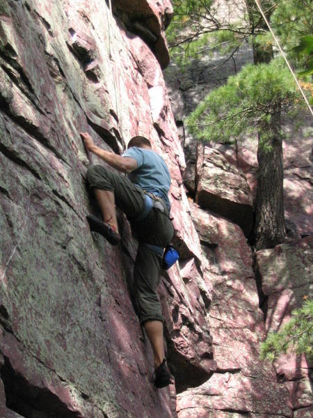 Rich searching for thin holds just above the block on Resurrection.