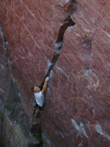 Travis Melin placing pro on the crux of Birch Tree crack 5.8. Photo Mike Lopera.