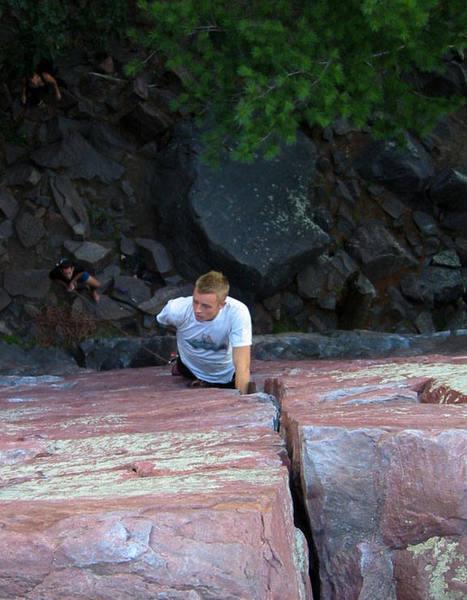 Travis Melin high on Birch Tree crack 5.8. Photo Mike Lopera.
