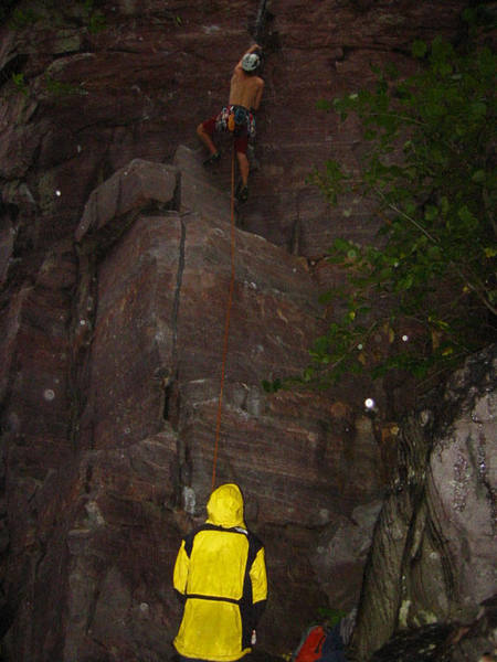Dan F starting the lead of Sometimes crack 5.10a in the middle of the rain. Photo Mike Lopera
