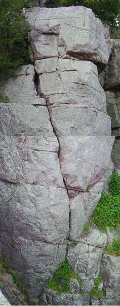 Jack of Spades (5.6) goes up the diagonal crack and just to the right of the corner