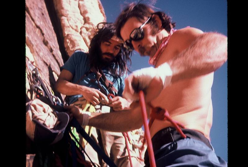 """Jimmy Newberry and Geoff """"Madman"""" Conley re-racking on the 1st continuous ascent of Eagle Dance, Dec 1980. Photo by Phil Broscovak"""