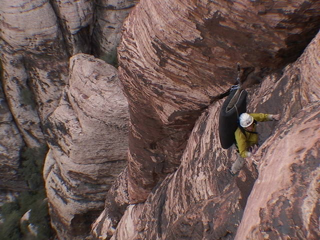 It was a cold day in the fall of 2003 when two intrepid explorers (Sue not pictured) were coerced to climb Olive Oil burdened with crash pads.  The destination being a boulder problem in the descent gully which Hans bravely ascended.