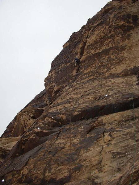 A snow flurry on pitch 3 of Hot Fudge Thursday.  At this point the route traverses left out of the main crack and follows good holds and small cracks out on the face.
