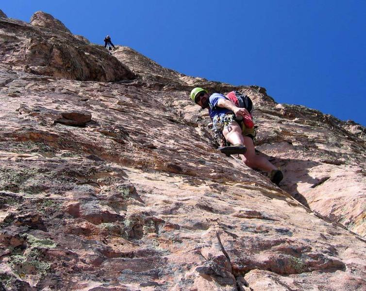 """Starting pitch 7, the """"S Crack Pitch"""".  The climber above is at the hanging belay that ends this pitch."""
