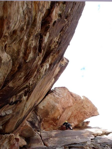 The 5.7 variation of Peaches. Note the 5.9 overhanging lieback variation to the left and the 5.5 crack to the right of Mike.