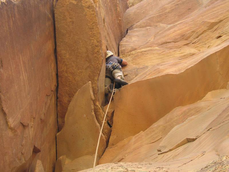 Josh climbs p4 of Triassic Sands
