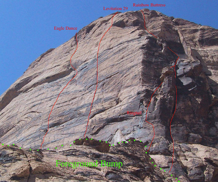 "Eagle Wall from the lower Painted Bowl with routes marked (note that bottom pitches of these routes are not visible due to the ""foreground bump"")"