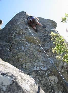 Brian pulls his way up the crack just before the crux. Copyright 2002 Melissa Moore