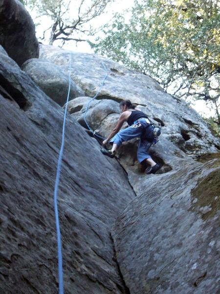 Sallie at the top of the 5.6 dihedral.  Moving left here is the crux of the corner.