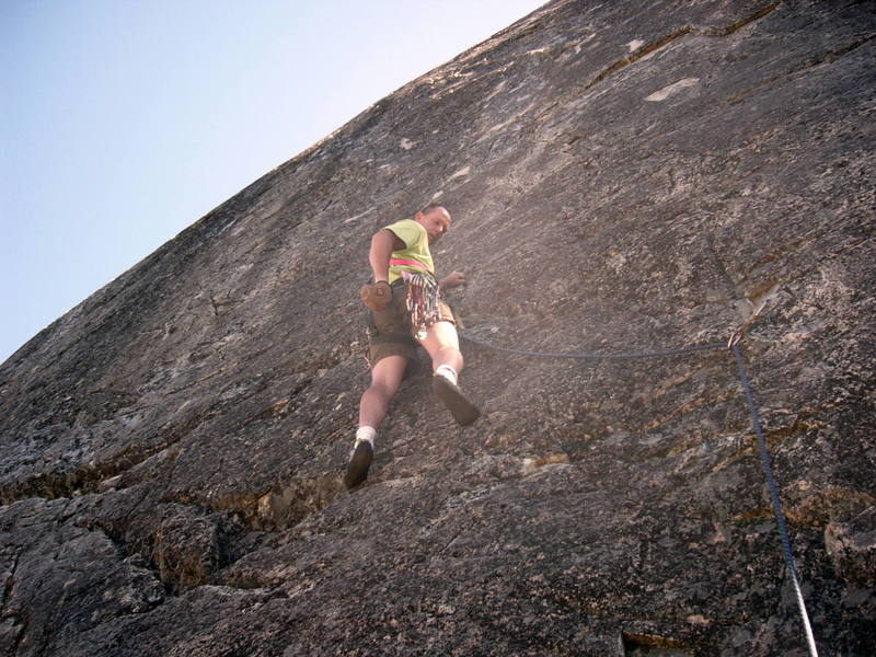 Paul at second bolt.  Climb continues up through the slightly whitish rock above.  That's where the fun starts!