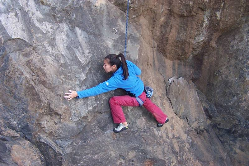 Naoko staying low on the bottom of the climb.  She needs to get to the handhold down and to her left about 8 inches.