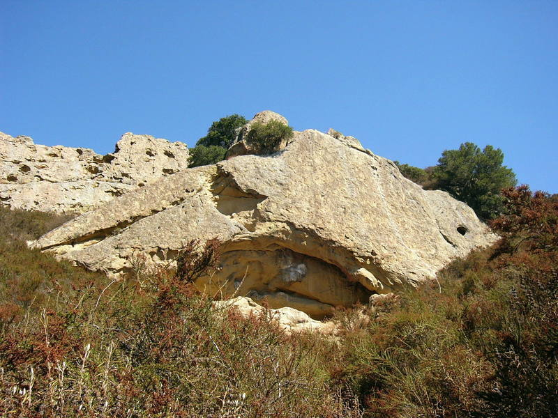 Photo taken from the path leading directly down from Flintstone Rock on a beautiful, sunny day. Route shown is the only bolted route on the Flintstone Rock, Yabba Dabba Dudes (10a). Sept 25, 2005.