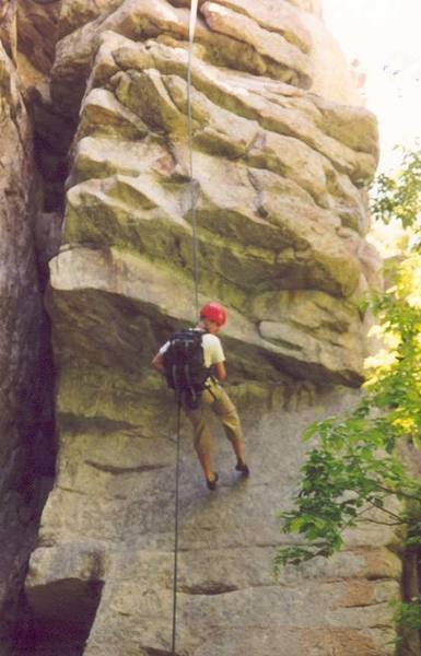 Rapping past the crux roof on Extreme Unction in Ferguson Canyon.