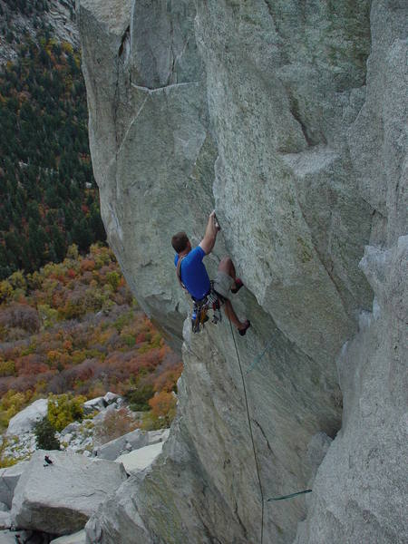 Andrew pulling through the first crux on Gordon's Hangover.
