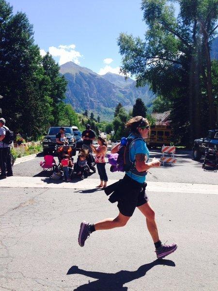 Michelle runs into Telluride down the last stretch to the finish line.