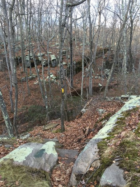 Descending a rocky, granite ridge on Sap Brook Trail.