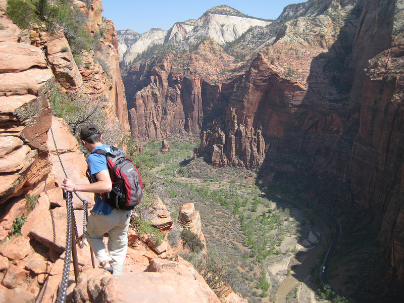 An interpid hiker descends the Angels Landing route with near 1000 foot drops on both sides. NPS Photo/Caitlin Ceci