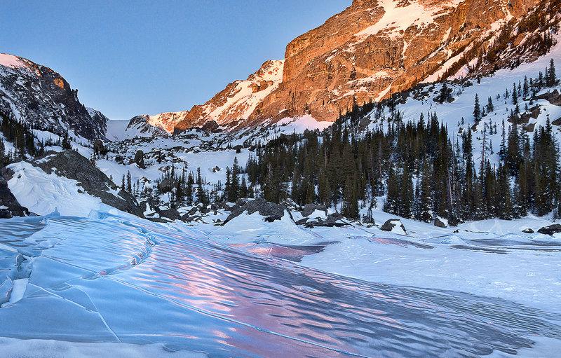 Tilted ice, rosy sunrise