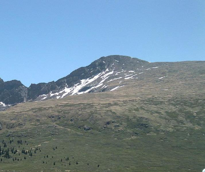 Mt. Bierstadt from the main TH. Much of the route is visible, with the trail starting from the lower left of the picture and jogging up the center hill. From here it passes along the summit ridge to the right. The sawtooth is to the left of the summit.