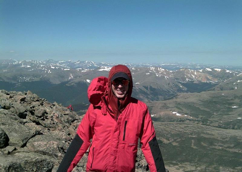 A lowlander friend summits his first 14er, with some amazing views of the Front Range behind him.