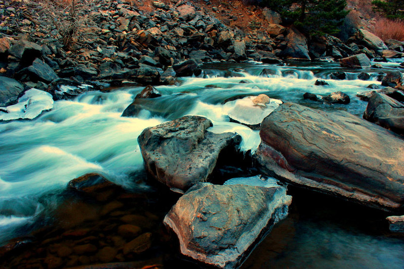 A pleasant creek with interestingly colored rocks.