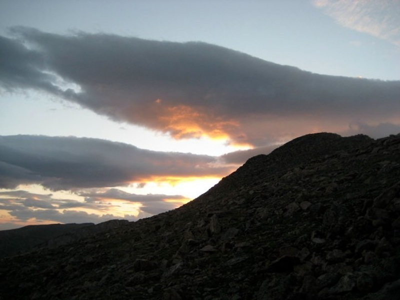 View of the summit ridge at sunrise, just as the going gets tough. An early start is highly recommended - better views, fewer crowds, and a dryer day are almost guaranteed.
