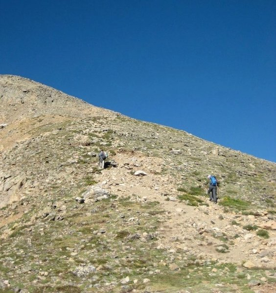 The crux of the route, a steep and slightly rocky pitch before the first false summit.