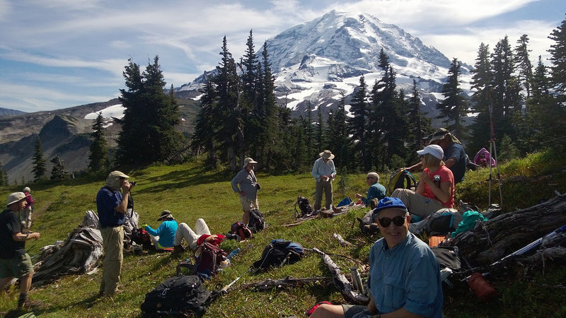 A group taking a well-deserved break at a pretty nice viewpoint...