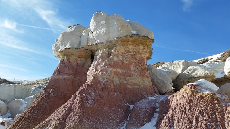 Sandstone capped spires with clay containing oxidized iron- Paint Mines Park