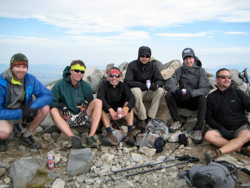 Tired hikers on the summit after successive days of tackling the 14ers of the Sangre de Cristo Range.