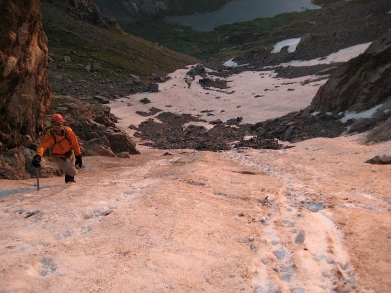 Climbing up some snow on Broken Hand Pass, July 2011.