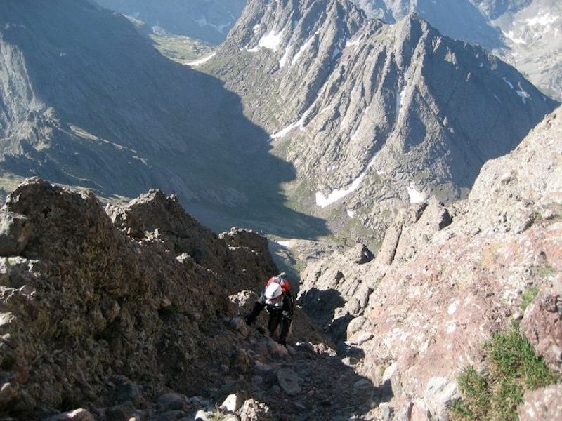 A hiker popping out of the west gully just before reaching the summit.