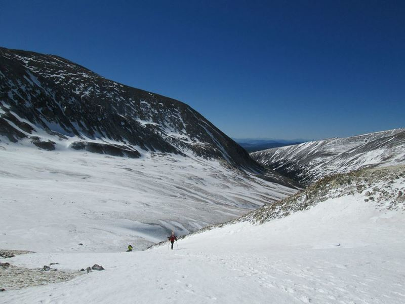A hiker/skier working toward the fun part of this climb: a spring ski descent.