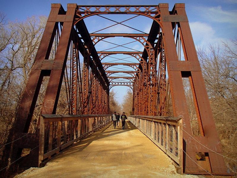 Runners cross the Elm Creek Bridge on the Southwind Rail Trail near Iola, Kansas.