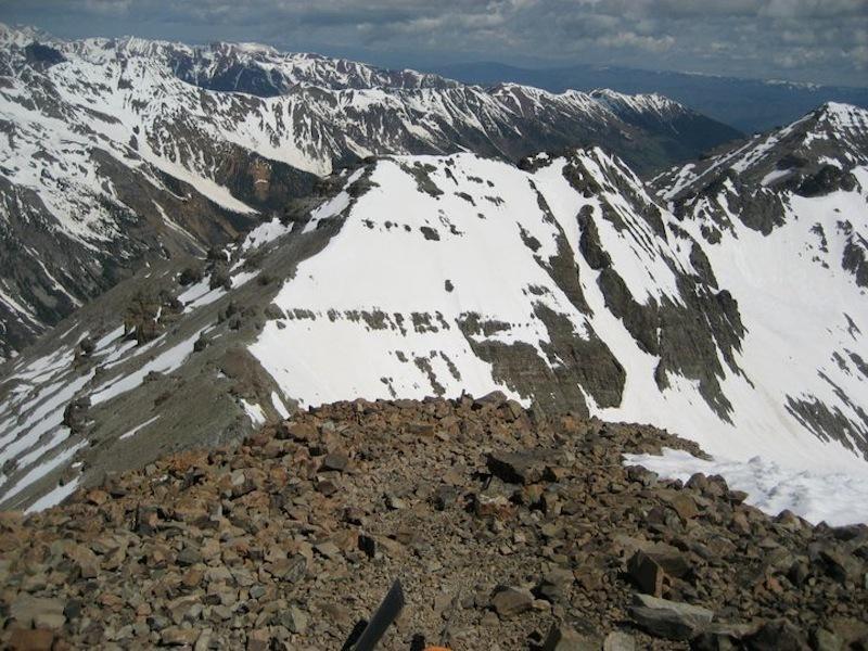 View from the summit of Castle Peak. To the left is the saddle to which you'll descend. Conundrum is right in front of you, with its technical couloir just right of center. Conundrum's summit is up and to the right of the couloir.