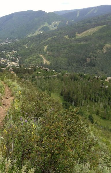 Starting the descent, with views of Vail and the Gore Range.