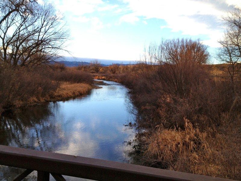 Peaceful resting spot on the wooden bridge across Boulder Creek.