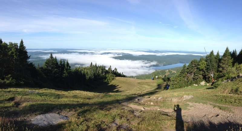 This overlook from Mt. Tremblant summit shows Lake Tremblant partially under cover of morning fog.  This was August, with temperatures in the 40's at the base, and 60's at the peak.