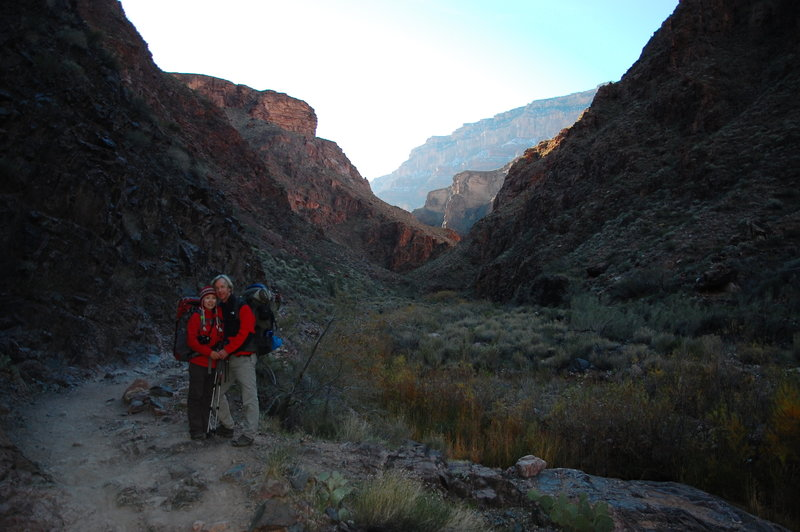 Some hikers using the last tendrils of daylight for a photo.