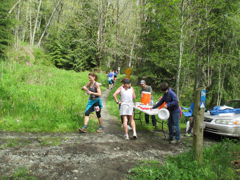 Trail runners refueling at an aid station during the 2014 OAT Run, held on this trail every April.