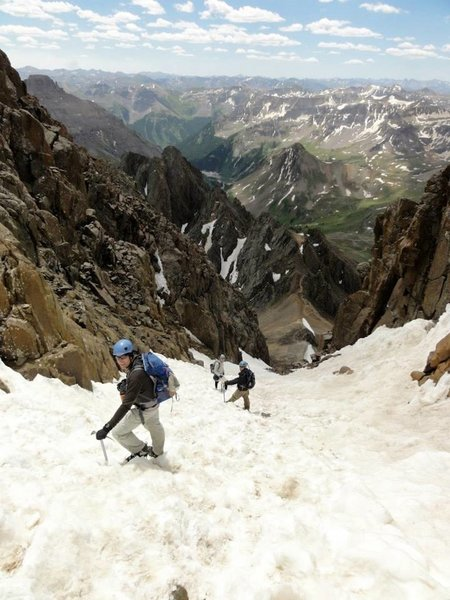 Hikers descending the gully, not far from the summit. The 13,500 ft saddle can be seen in the distance.