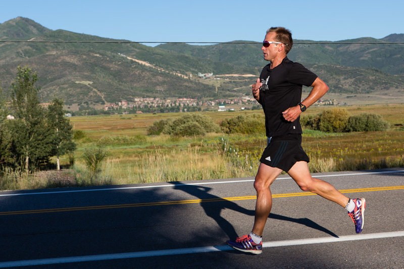 A runner crushing the road portion of the Park City Half.