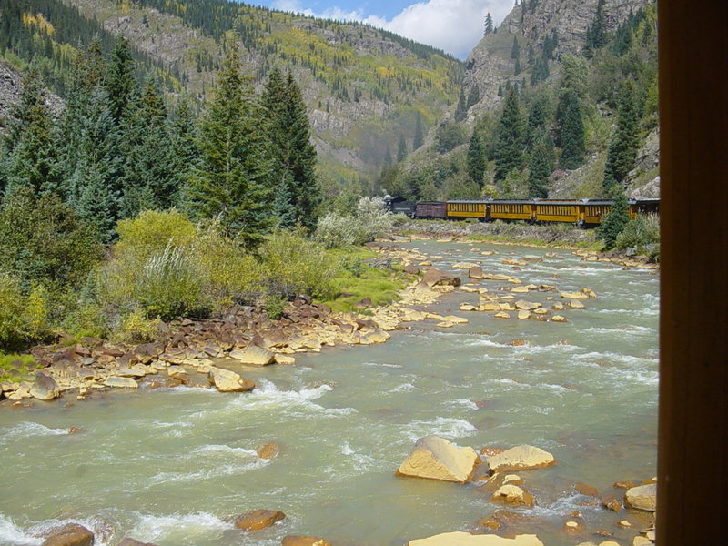 Train traveling along the Animas River