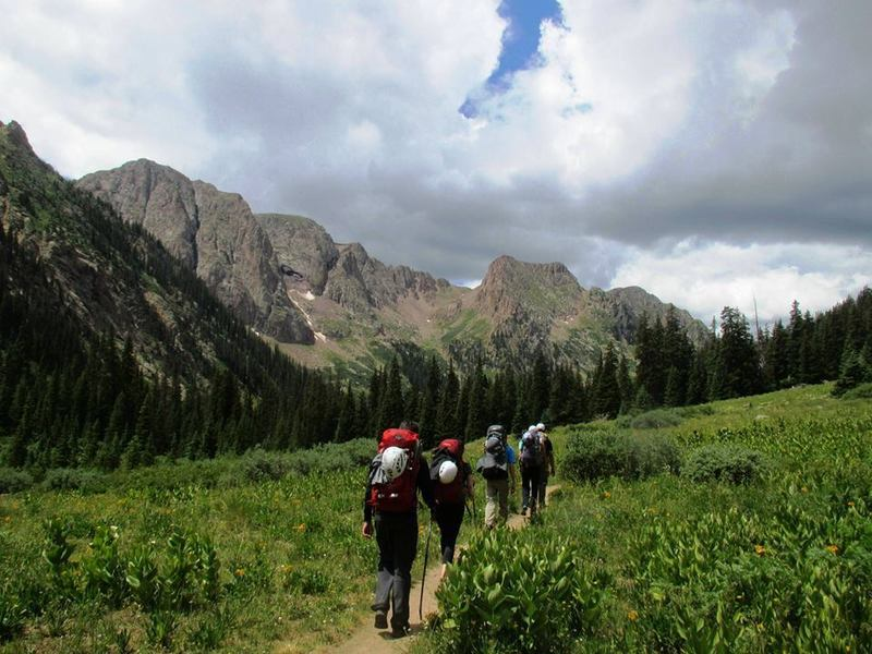 Hikers stroll into camp with Chicago Basin's Needle Mountains in the background. You wanna go here now, don't you?  Chicago Basin Trail