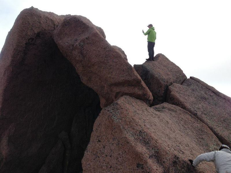 Look at this guy, just standing near the exposed summit. No big deal. The climber on the lower right can be seen working her way up the slab. From the higher hiker, it's just two jumps onto the highest boulder.