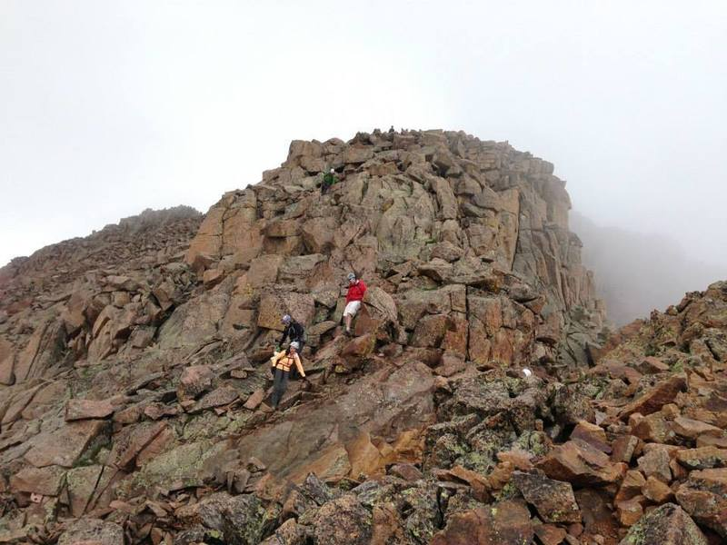 Just above the gully, a look at the standard scrambling along Sunlight Peak's standard route.