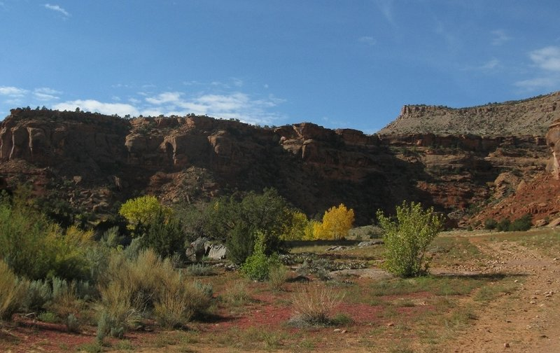 Following the old road between the red sandstone cliffs