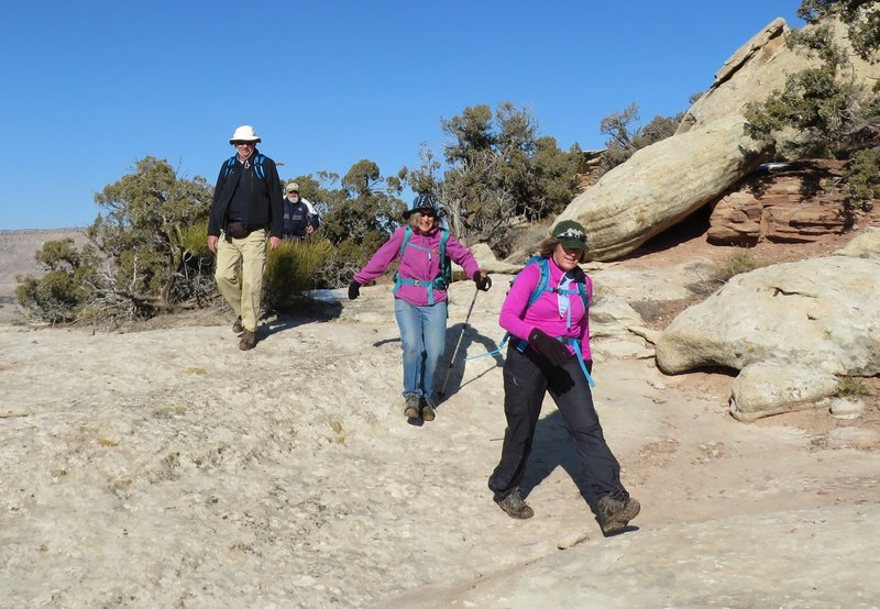 Hiking across slick rock. Just watch for cairns to find the next segment of trail.